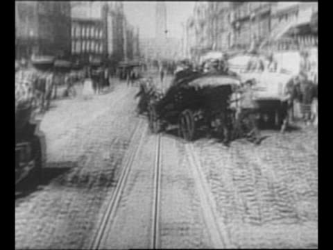 from inside cable car as it moves on track through san francisco after earthquake as pedestrians, cars, carts move nearby / horse-drawn carts and... - newsreel stock videos & royalty-free footage