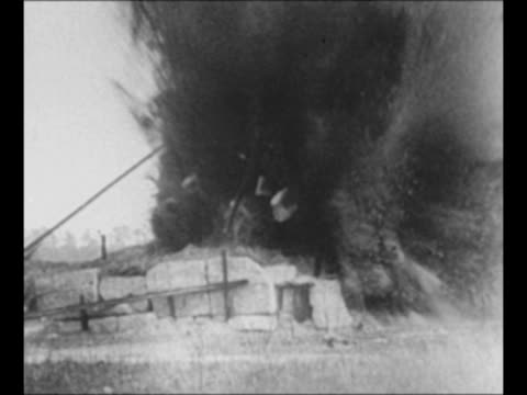 stockvideo's en b-roll-footage met from inside cockpit as bomber flies low over ground; pilot's hands at controls in left foreground / aerial b-24 flies low over trees / pilot's hands... - pilot