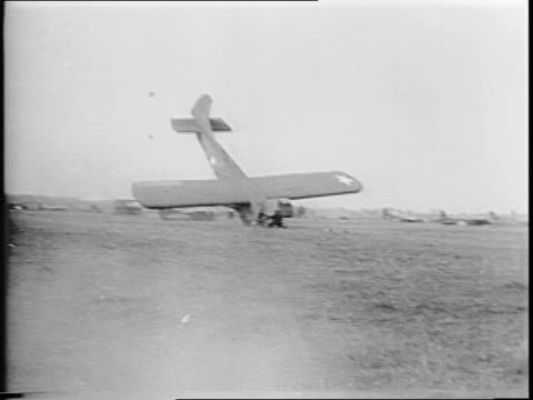 from inside glider of tow plane and rope / gliders landing, several planes, including a waco cg-4a, crashing / planes burning and smoke rising / wide... - 1944 stock videos & royalty-free footage