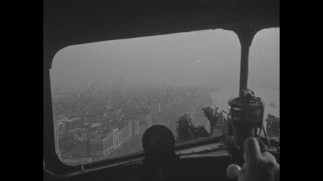 POV from inside small airplane over line of US naval vessels / ship following others in New York Harbor / aircraft carrier with planes on deck /...