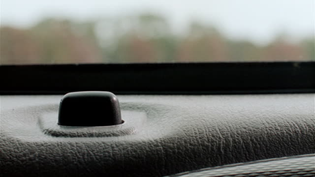 pov from interior a contemporary vehicle, the door closes and lock is engaged. - lock stock videos & royalty-free footage