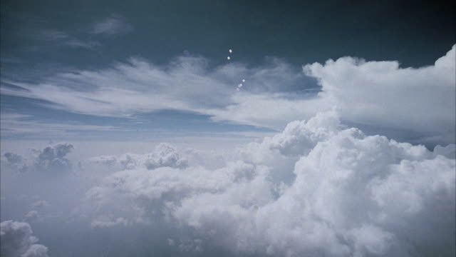 POV from jet flying above and through clouds