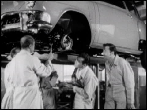 from judd holdren to group of young men learning about the brake assembly on a 1952 studebaker / group of young studebaker trainees learning about a... - south bend indiana stock videos & royalty-free footage