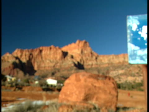From large red field red rock mountain cliffs mountains BG to MS dilapidated outdoor basketball hoop backboard field BG Mohave County Arizona Strip...