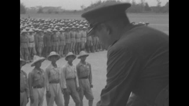 from large stage pan republic of china troops lined on parade ground as aids prep stage for general sun lijen / general sun salutes / vs he hands... - chiang kai shek stock-videos und b-roll-filmmaterial