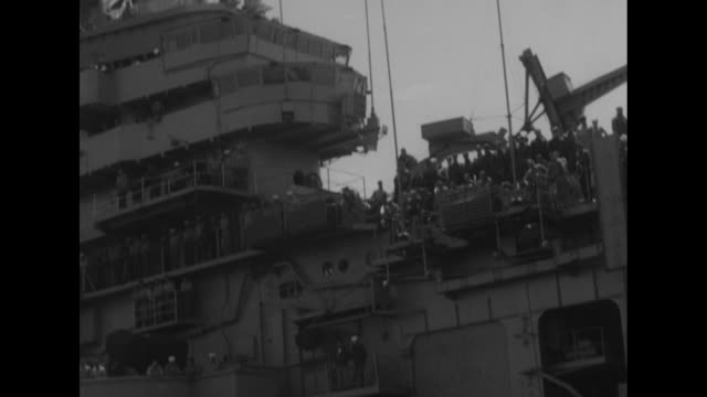 from low-flying aircraft of uss bennington nearing dock of nas quonset point / helicopter takes off from the bennington / sailors lay empty... - soot stock videos & royalty-free footage
