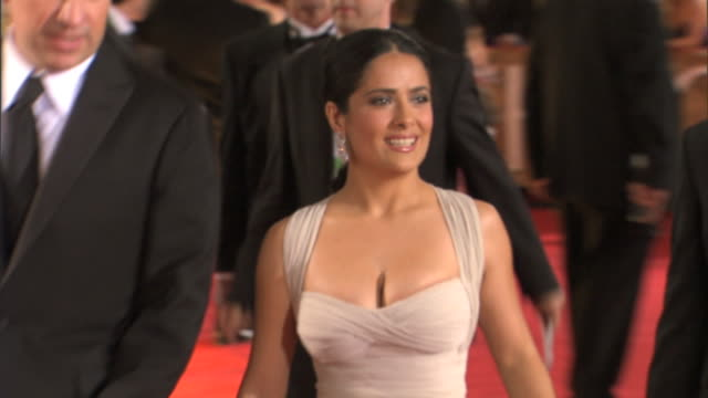 ZO from MCU to MS Salma Hayek walking down red carpet speaking and waving along the way