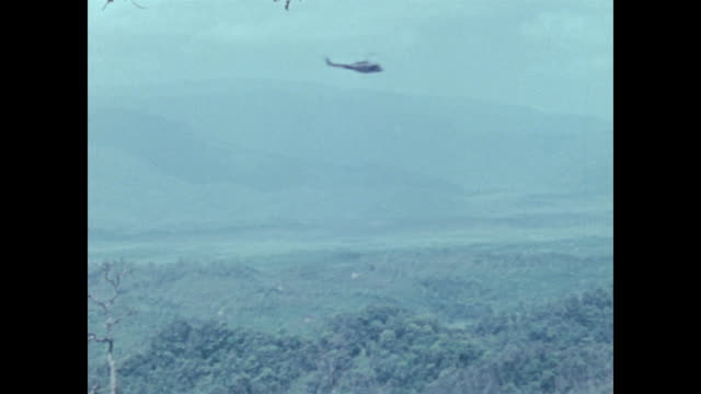 From mountain camera pans the A Shau Valley as Huey flies by a stronghold of the North Vietnamese and part of the Ho Chi Minh Trail