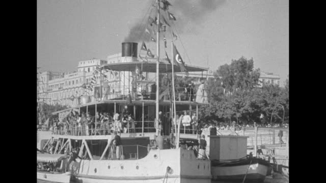 from moving boat of egyptians standing on the bank of the nile river / two children smile, clap their hands / small steamship moves away / crowd... - 1910 1919 stock videos & royalty-free footage