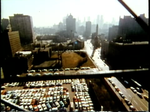 1963 POV WS From moving elevator with city skyline in background from moving elevator / Chicago, United States / AUDIO