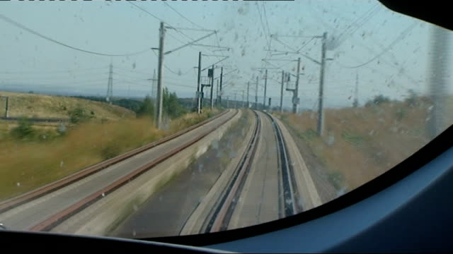 from moving high speed eurostar train on rail link between london and belgium train driver at controls from front of moving train more of train... - in front of点の映像素材/bロール