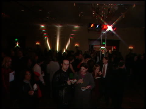 from on row of yellow, blue, red and orange blinking spotlights to pan over party crowd - sundance film festival点の映像素材/bロール