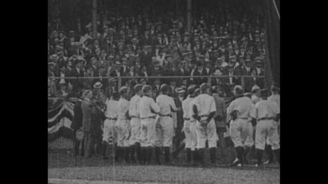 vídeos de stock, filmes e b-roll de [from paramount screen souvenirs, 1932] new york giants baseball players drive past in cars belching exhaust as they circle the baseball field / the... - moving past