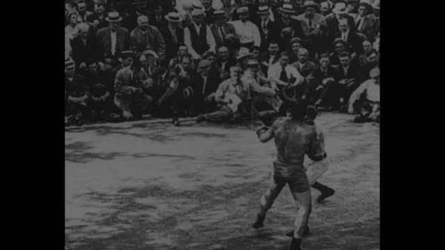 [from paramount screen souvenirs 1932] [with added vo humorous narration throughout not part of original footage] [october 1909] boxers john sullivan... - santa cruz california stock videos and b-roll footage