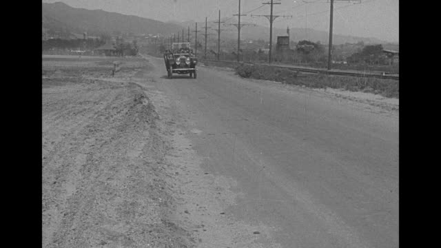 [from paramount screen souvenirs] [actual film title unknown] no title card / silent film in which car drives toward camera, man in suit and hat... - husband stock videos & royalty-free footage