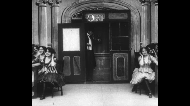 [from paramount screen souvenirs1 1933] [vo humorous narration throughout] title card a shocking girlygirly scene from 'the nudities of 1909' which... - 1900 1909 stock videos and b-roll footage