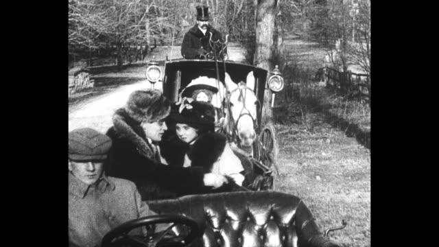 stockvideo's en b-roll-footage met [from paramount screen souvenirs1 1933] [vo humorous narration throughout] title card while riding in the park hannah sees her loving man is doing... - 1900 1909