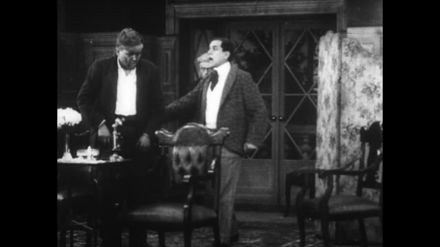 [from paramount screen souvenirs12 1934] [with added vo humorous narration throughout not part of original movie] title card fate's strange trick... - passing a note stock videos & royalty-free footage