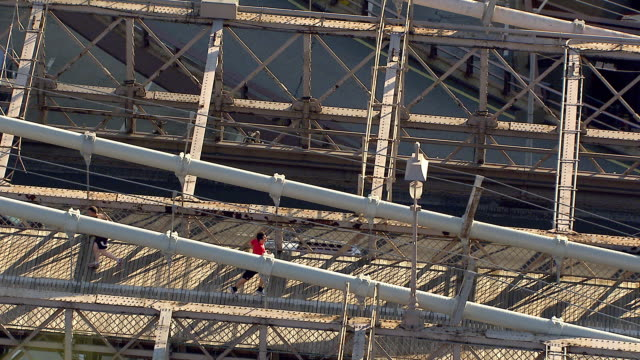 From pedestrians traffic moving on Brooklyn Bridge to TU WS Lower East Manhattan highrise buildings skyscrapers including Verizon building Manhattan...
