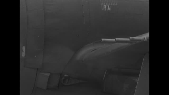 mspan from pilot loading bag into b17 bomber to nose of plane with hell's angels painted below the nose gun / ms wing guns firing / vs low angle rear... - biker gang stock videos & royalty-free footage