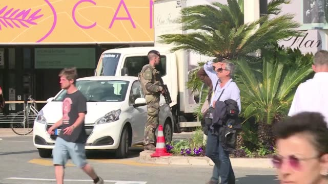 from police and army troops patrolling the area to sniffer dogs and roadblocks security is reinforced in the french coastal city of cannes as the... - 71st international cannes film festival stock videos & royalty-free footage