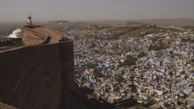 pan from rampants of mehrangarh fort to ha ws of jodhpur - fortress stock videos and b-roll footage