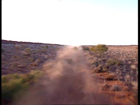 MS POV from rear of vehicle, showing dust cloud in desert