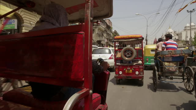 pov from rickshaw through busy delhi streets - auto rickshaw stock videos & royalty-free footage