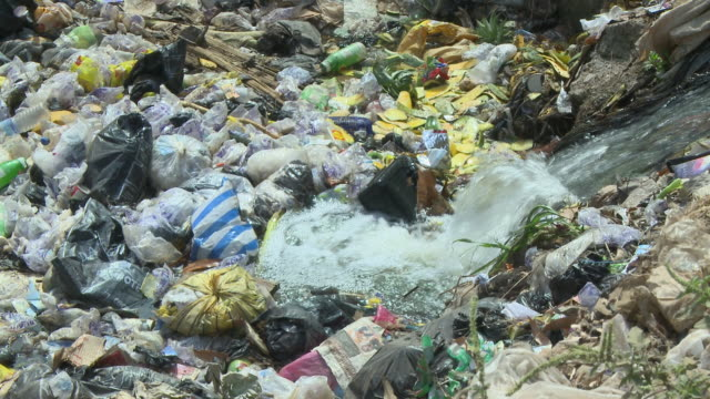 tilt up from rubbish in the river to the street nigeria is home to nearly 200 million people which has earned it the name giant of africa it is an... - jos nigeria stock videos & royalty-free footage