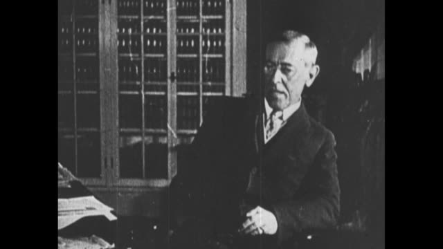 "[from scripps-howard documentary about woodrow wilson] title card: ""secretary of war baker appraises his fine war-material at west point"" / us war... - chairperson stock videos & royalty-free footage"
