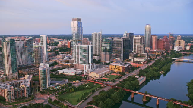 aerial from seaholm to second street district in austin, tx, at sunset - austin texas stock videos & royalty-free footage
