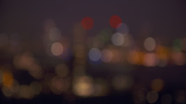 from sharp to unsharp. lights of rotterdam skyline illuminated at dusk, aerial view. - rotterdam stock videos & royalty-free footage