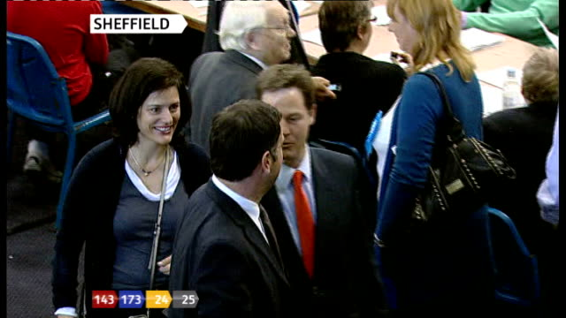 nick clegg and wife miriam gonzalez durantez chatting to people in counting hall - ニック クレッグ点の映像素材/bロール