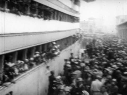 pan from ship crowded with sailors to crowd on dock at port / san francisco / newsreel - 1927年点の映像素材/bロール