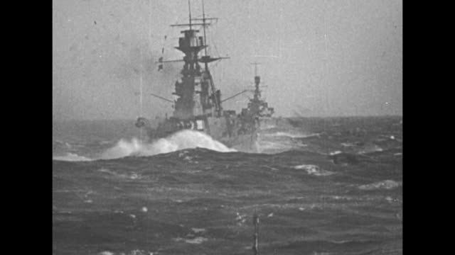 vidéos et rushes de from ship in front of line of british warships sailing along / shot on board ship of its bow as ship plows ahead / shot from ship in front of line of... - professional occupation
