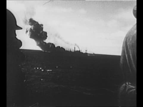 from ship of explosions near another ship during supply transport in world war ii / sailor in turret, wearing life belt and helmet / rear shot... - 船の一部点の映像素材/bロール