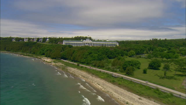 aerial from shoreline to grand hotel/ mackinac island, michigan - unknown gender stock videos & royalty-free footage