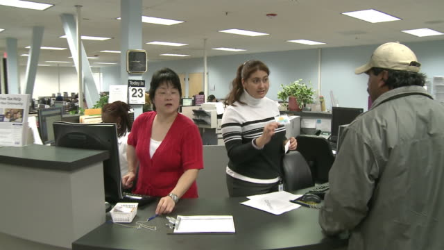 from sign to people at reception desk in job center/ antoch, california, usa/ audio - 2009 stock videos & royalty-free footage