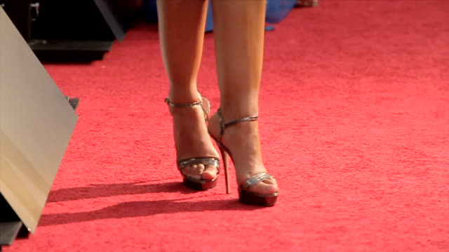 from stiletto heel shoes to janina gavankar posing for paparazzi on the red carpet at the arclight cinemas cinerama dome - high heels stock videos & royalty-free footage