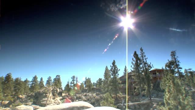 GLARE from sun top of frame Big Bear rocks boulders PAN to LA WS ski lodges houses trees n