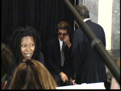 vídeos de stock, filmes e b-roll de zo from ted danson laying down and sitting up in background to whoopi goldberg talking to reporters - ted danson