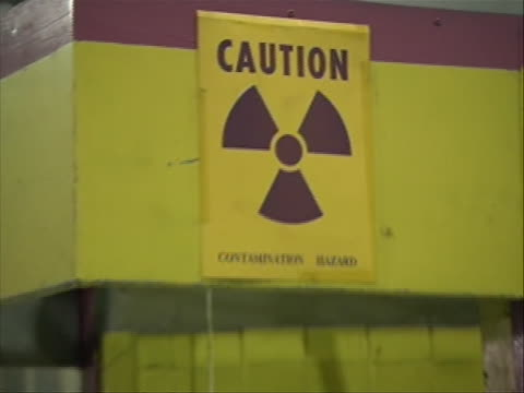 from tehran, iran in the tehran nuclear facility / research reactor. elements fed in on january 17, 2011 caution sign with hazard symbol w - nuclear weapon stock videos & royalty-free footage