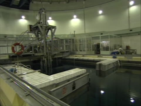 from tehran, iran in the tehran nuclear facility / research reactor. elements fed in on january 17, 2011 water in cooling pool at iran nuclear... - nuclear weapon stock videos & royalty-free footage