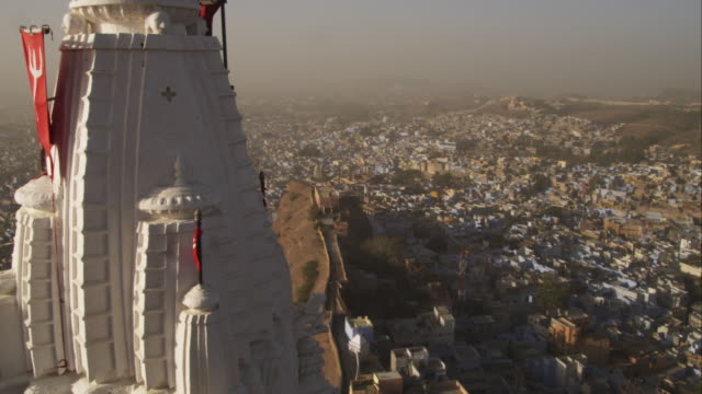 pan from temple at mehrangarh fort to ha ws of jodhpur - fortress stock videos and b-roll footage