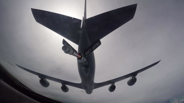 A KC135 from the 927th Air Refueling Wing from MacDill Air Force Base Fl fuels a B52 Stratofortress from Barksdale Air Force Base La The B52 flew in...