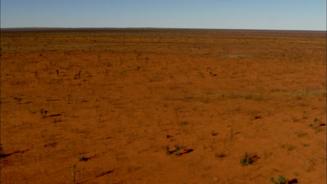 from the air, the australian outback appears as a dry and infertile wasteland stretching endlessly toward the distant horizon. - outback stock videos & royalty-free footage