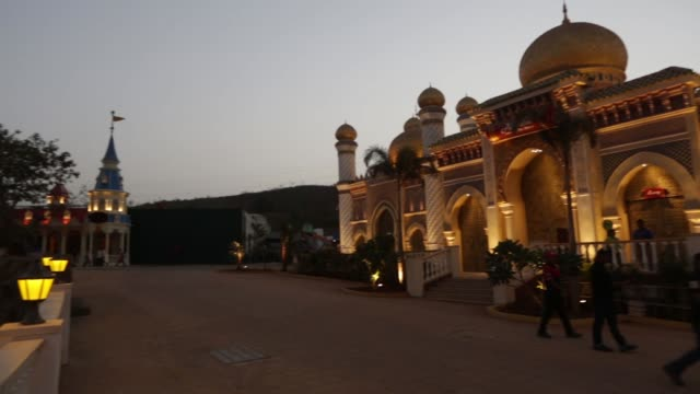PAN from the Alibaba Aur Chalis Chorr ride to waterfront area at Adlabs Imagica theme park at night operated by Adlabs Entertainment Ltd during its...