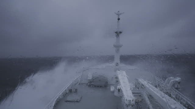from the bridge of a fishing boat in a stormy sea - nave a vela video stock e b–roll