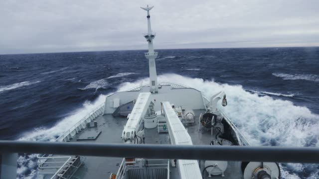 from the bridge of a fishing boat in a stormy sea - nautical vessel stock videos & royalty-free footage