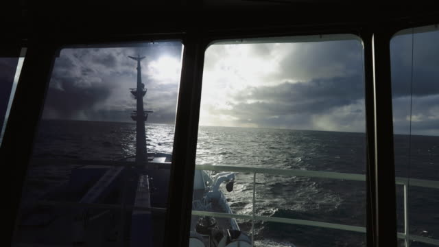 from the bridge of a fishing boat in open sea - ship's bow stock videos & royalty-free footage